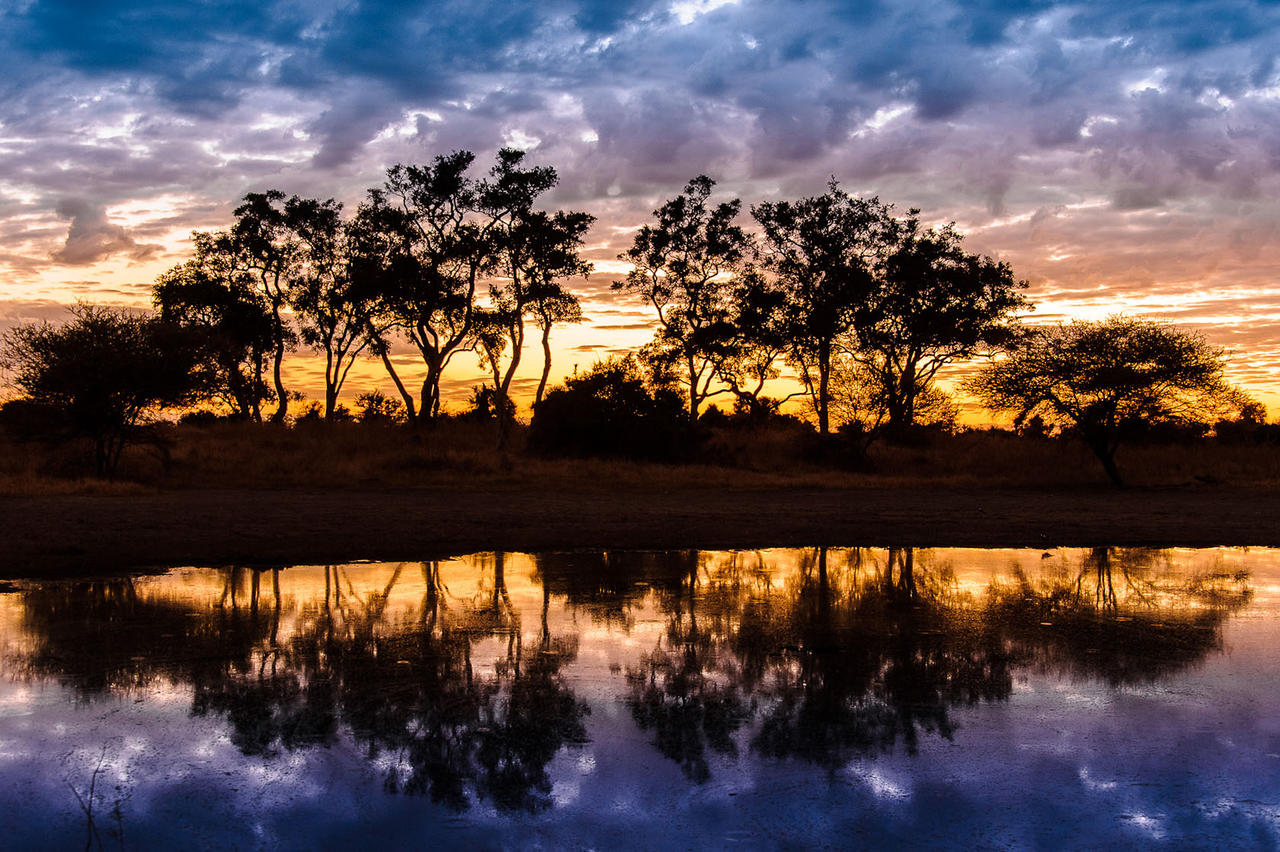 Little Momba Camp Sunset Okavango Delta Botswana